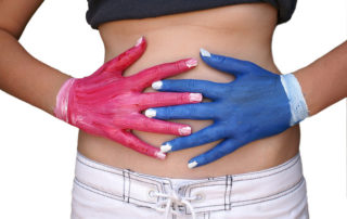 red and blue hands placed over stomach