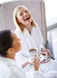 women laughing in spa